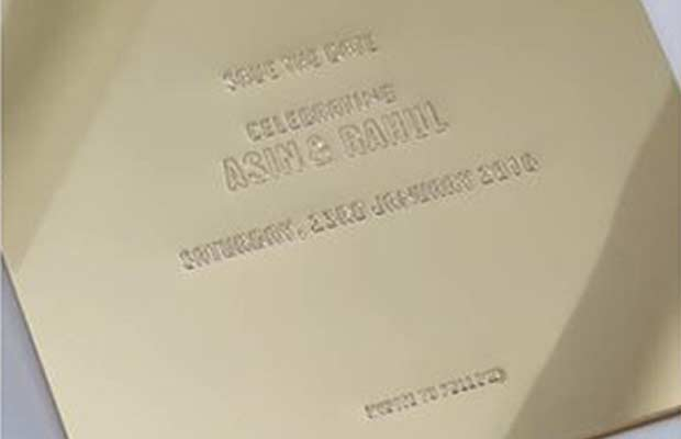 Check Out Asin And Rahul Sharmas Gold Wedding Card